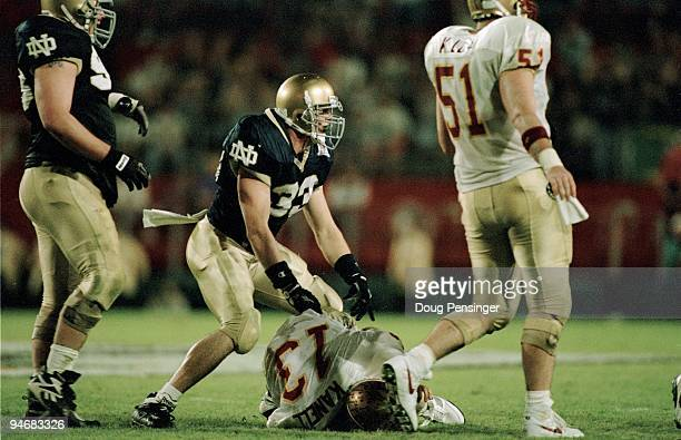 John McLaughlin of the Notre Dame Fighting Irish celebrates over a fallen Danny Kanell of the Florida State Seminoles during the 1996 Orange Bowl on...