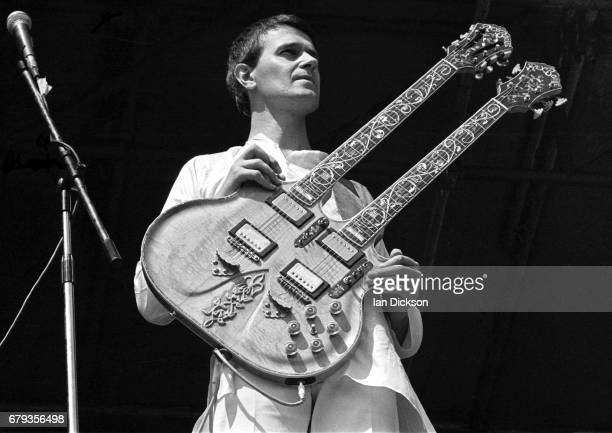 John McLaughlin performing on stage with Mahavishnu Orchestra at Knebworth Festival, Knebworth House, Hertfordshire, 20 July 1974.