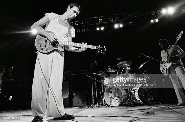 John McLaughlin performing with the jazzfusion group Mahavishnu Orchestra at the 1975 Orange Rock Festival