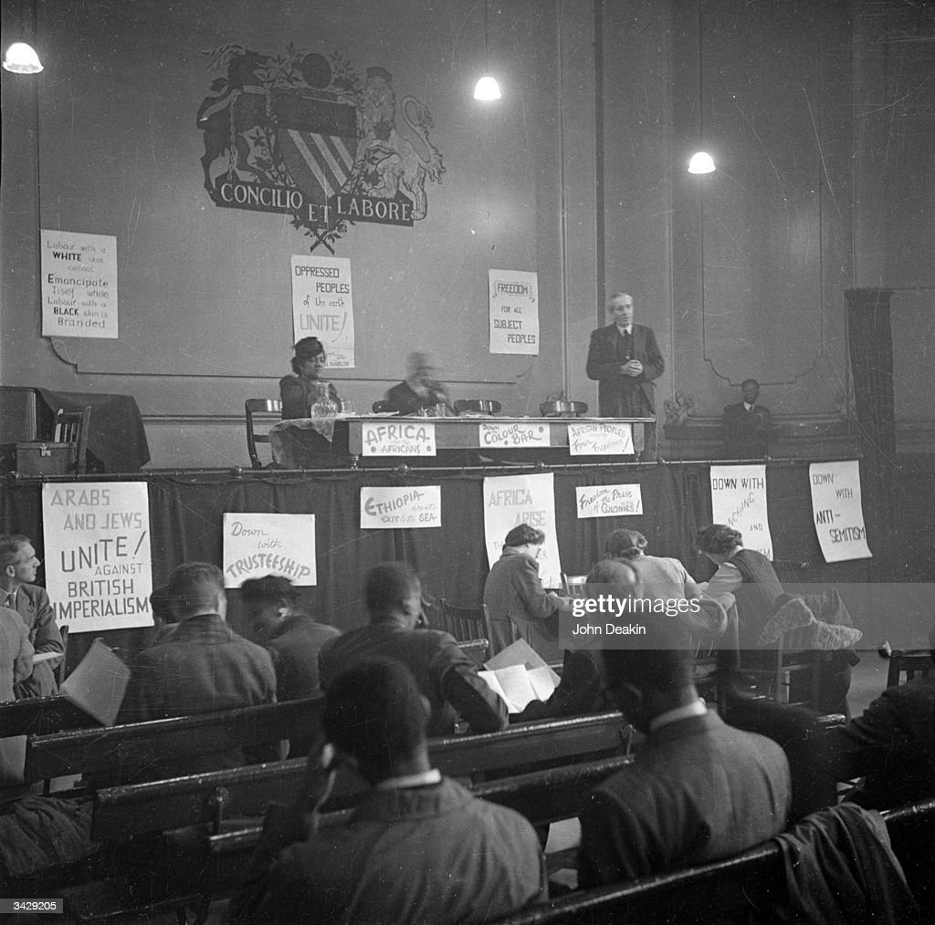 John McNair, General Secretary of the ILP (Independent Labour Party) addresses the first Pan-African Congress in Manchester. Also on the stage is Amy Jacques Garvey, the second wife of Marcus Garvey. Original Publication: Picture Post - 3024 - Africa Speaks In Manchester - pub. 1945