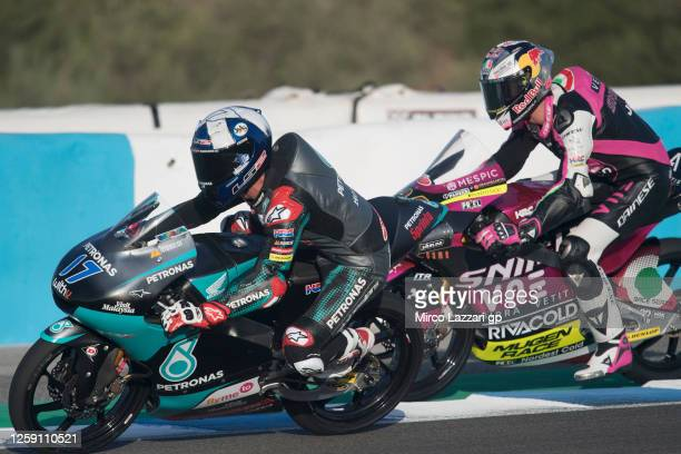 John McPhee of Great Britain and Petronas Sprinta Racing leads Tony Arbolino of Italy and Rivacold Snipers Team during the Moto3 race during the...