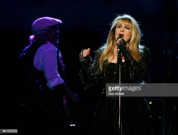 John McVie and Stevie Nicks of Fleetwood Mac performs on stage in concert at Acer Arena on December 7, 2009 in Sydney, Australia.