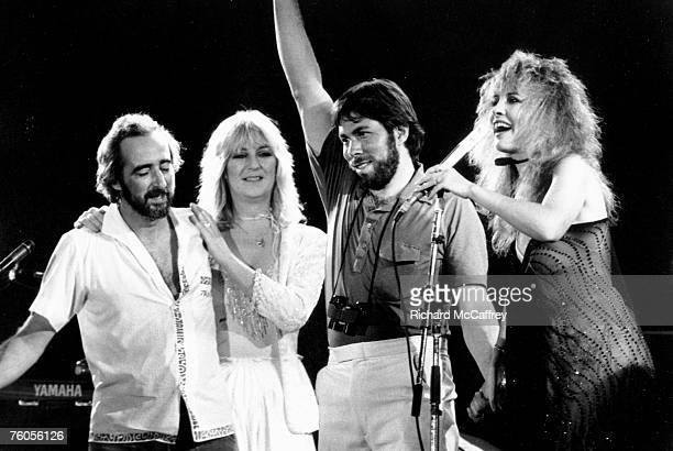 John McVie Christine McVie organizer and executive Steve Wozniak and Stevie Nicks of the rock group 'Fleetwood Mac' perform onstage at the US...