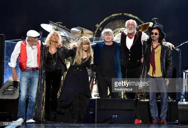 John McVie, Christine McVie, Stevie Nicks, Neil Finn, Mick Fleetwood, and Mike Campbell of Fleetwood Mac perform onstage during the 2018 iHeartRadio...