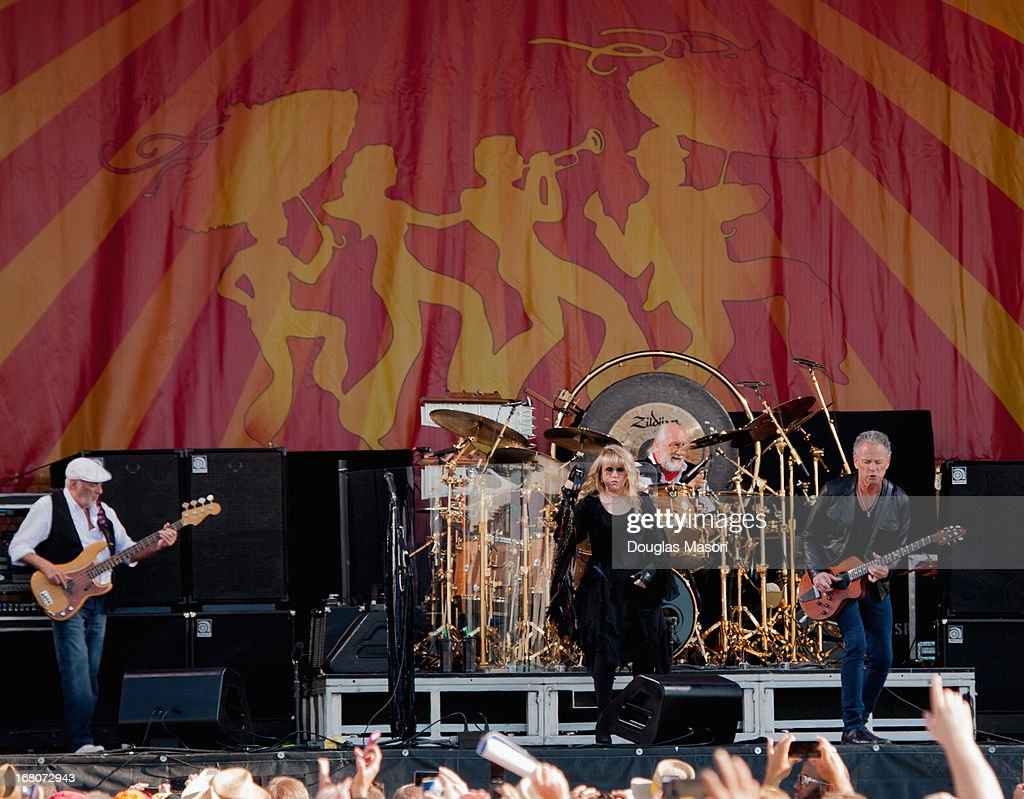 John McVie, Stevie Nicks, Mick Fleetwood and Lindsey Buckingham, of Fleetwood Mac perform during the 2013 New Orleans Jazz & Heritage Music Festival at Fair Grounds Race Course on May 4, 2013 in New Orleans, Louisiana.
