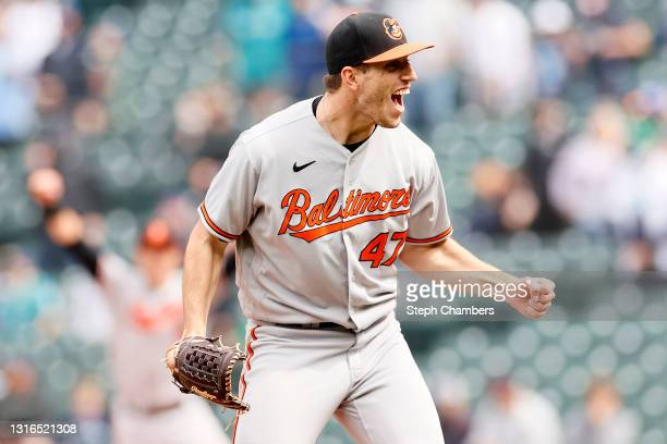 John Means of the Baltimore Orioles reacts after recording the final out of his no-hitter against the Seattle Mariners to win 6-0 at T-Mobile Park on...