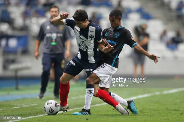 John Medina of Monterrey fights for the ball with Carlos Rossell Valentine of Atletico Pantoja during a second leg match between Monterrey and...