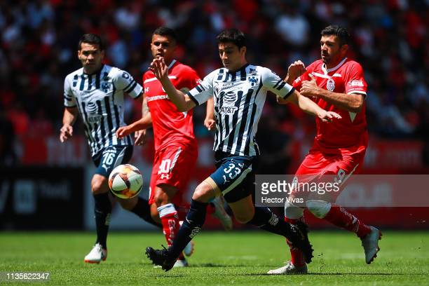 John Medina of Monterrey struggles for the ball with Emmanuel Gigliotti of Toluca during the 13th round match between Toluca and Monterrey as part of...
