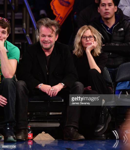 John Mellencamp and Meg Ryan attend the New York Knicks Vs Philadelphia 76ers game at Madison Square Garden on December 25 2017 in New York City