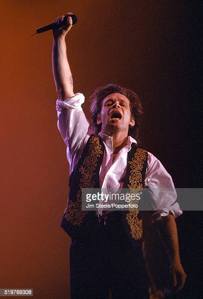 John Mellencamp performing on stage at the Wembley Arena in London on the 11th April 1992