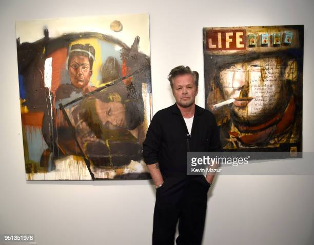 John Mellencamp stands in front of his work during private viewing of Life Death Love Freedom at ACA Galleries on April 25 2018 in New York City