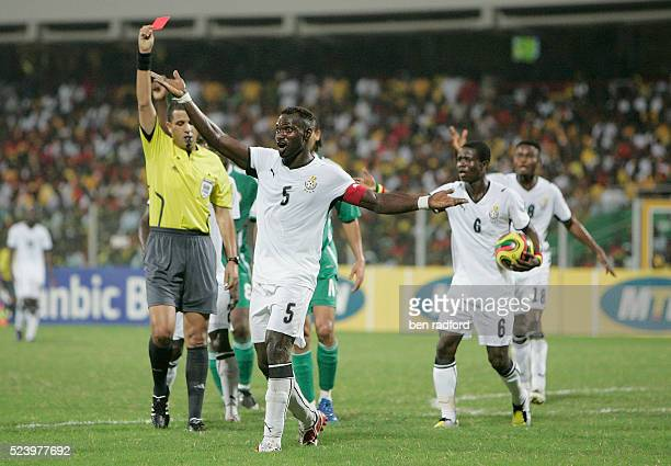 John Mensah of Ghana protests to the Assistant Referee aftyer being sent off by Referee Mohamed Benouza during the 2008 African Cup of Nations...