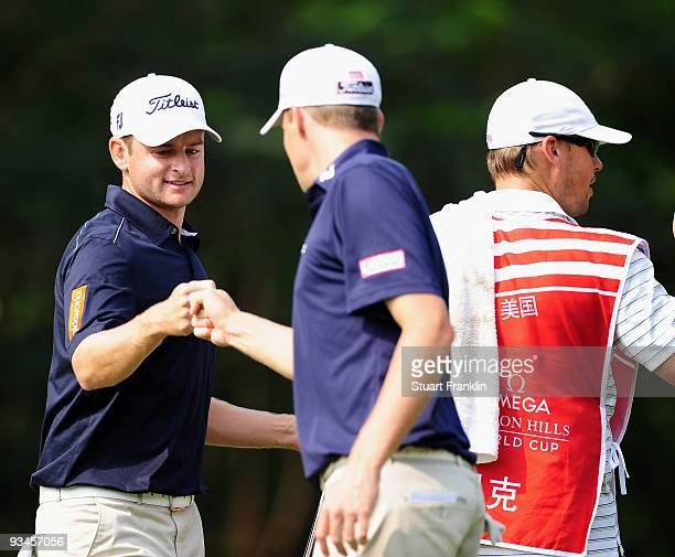 John Merrick and Nick Watney of USA celebrate on the 13th hole during Fourball on the third day of the Omega Mission Hills World Cup on the Olazabal...