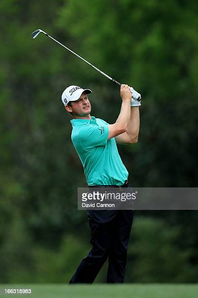 John Merrick of the United States hits his second shot on the fifth hole during the first round of the 2013 Masters Tournament at Augusta National...