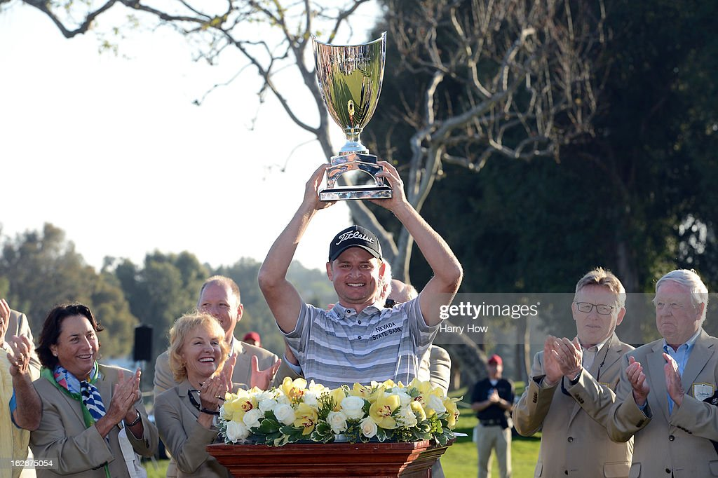 John Merrick poses with the trophy after his playoff win over Charlie Beljan on the second playoff hole during the final round of the Northern Trust Open at the Riviera Country Club on February 17, 2013 in Pacific Palisades, California.