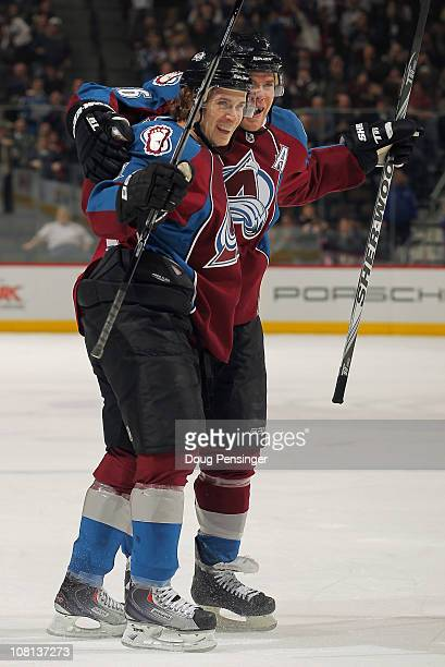 John Michael Liles of the Colorado Avalanche celebrates his first period goal against the Vancouver Canucks with teammate Paul Stastny at the Pepsi...