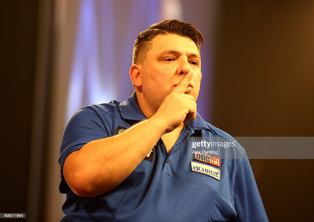 John Michael of Greece reacts during his first round match against Alan Norris of England during Day Four of the 2017 William Hill PDC World Darts Championships at Alexandra Palace on December 18, 2016 in London, England.