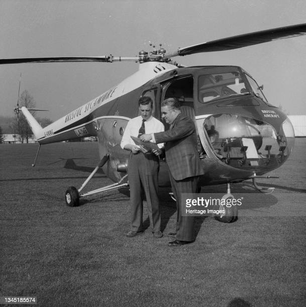 John Michie and a helicopter pilot deciding on a route to take back to the London to Yorkshire Motorway from a sports ground in Elstree, during a...
