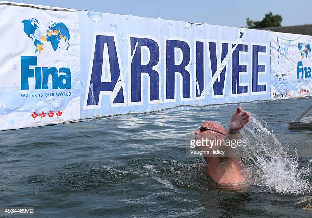 John Micks of Canada competes in the Men's 5054 Age Group 3km swim during the 15th FINA World Masters Championships at Parc JeanDrapeau on August 10...