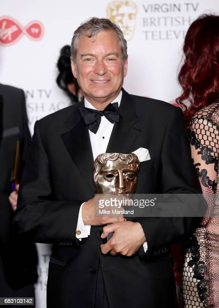 John Middleton poses in the Winner's room at the Virgin TV BAFTA Television Awards at The Royal Festival Hall on May 14 2017 in London England