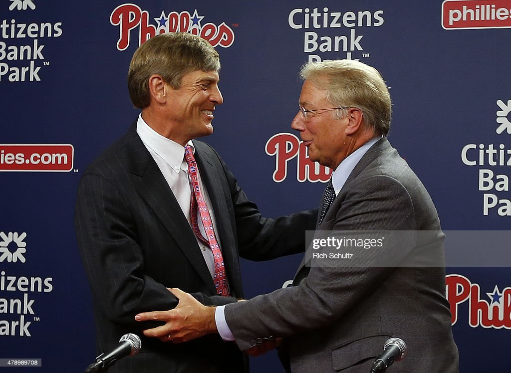 John Middletown, left, part owner of Philadelphia Phillies shakes hands with Andy MacPhail, right, after a press conference at Citizens Bank Park on June 29, 2015 in Philadelphia, Pennsylvania. MacPhail will take over for Pat Gillick as the teams' president after this season.
