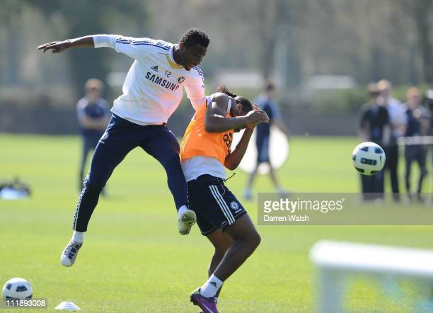 John Mikel Obi Didier Drogba of Chelsea during a training session at the Cobham training ground on April 8 2011 in Cobham England