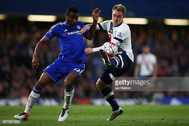 John Mikel Obi of Chelsea and Christian Eriksen of Tottenham Hotspur battle for the ball during the Barclays Premier League match between Chelsea and...