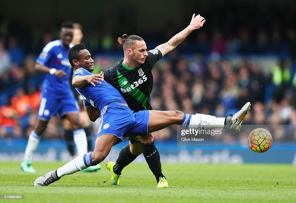 John Mikel Obi of Chelsea and Marko Arnautovic of Stoke City compete for the ball during the Barclays Premier League match between Chelsea and Stoke City at Stamford Bridge on March 5, 2016 in London, England.