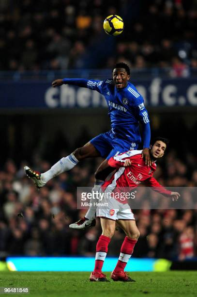 John Mikel Obi of Chelsea beats Cesc Fabregas of Arsenal to the header during the Barclays Premier League match between Chelsea and Arsenal at...