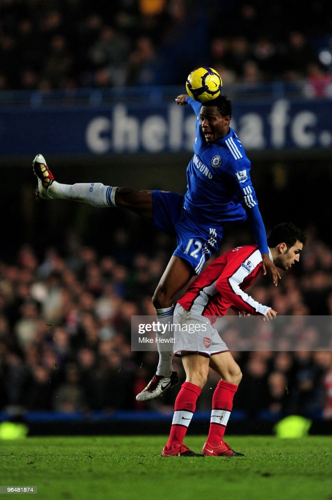 John Mikel Obi of Chelsea beats Cesc Fabregas of Arsenal to the header during the Barclays Premier League match between Chelsea and Arsenal at Stamford Bridge on February 7, 2010 in London, England.