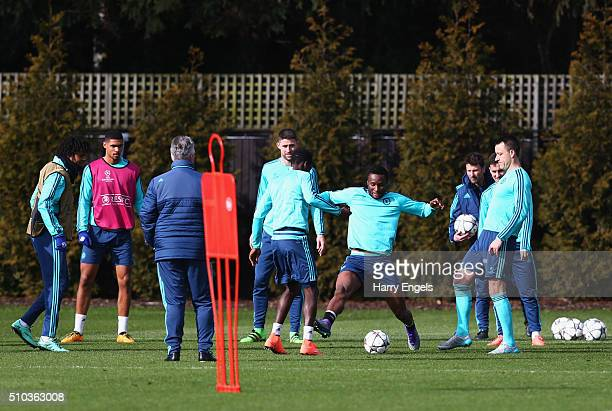 John Mikel Obi of Chelsea performs a drill with team mates during a Chelsea training session ahead of their UEFA Champions League round of 16 match...