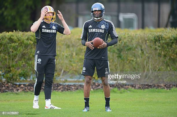 John Mikel Obi Sam Hutchinson of Chelsea plays some American Football after a training session at the Cobham training ground on May 1 2012 in Cobham...