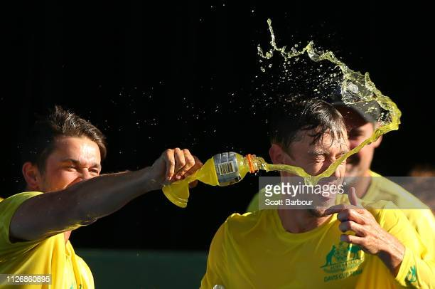 John Millman and Jordan Thompson spray Gatorade as they celebrate after winning the Davis Cup Qualifiers between Australia vs Bosnia and Herzegovina...