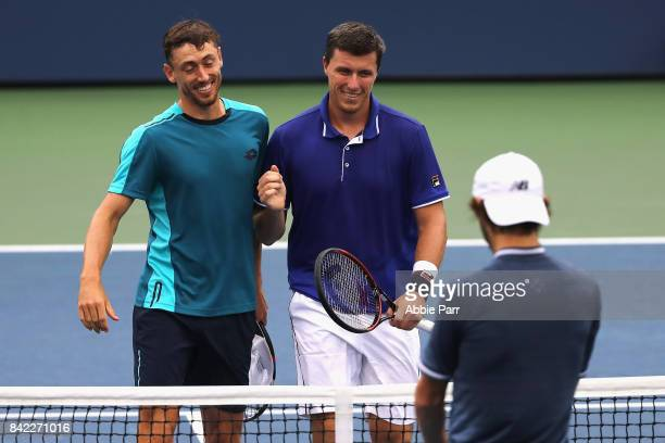 John Millman of Australia and Ken Skupski of Great Britain in action during their men's doubles second round against Jordan Thompson of Australia and...