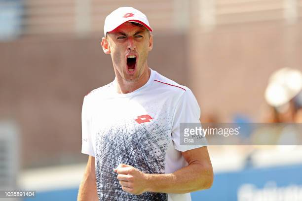 John Millman of Australia celebrates a point during his men's singles third round match against Mikhail Kukushkin of Kazakhstan on Day Six of the...
