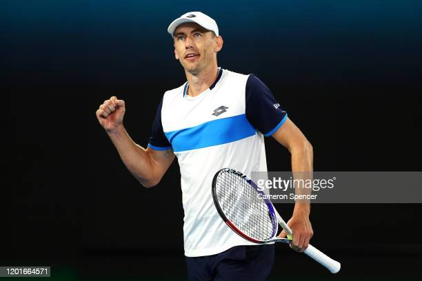 John Millman of Australia celebrates after winning a point during his Men's Singles third round match against Roger Federer of Switzerland on day...