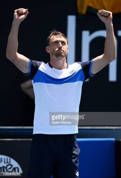 John Millman of Australia celebrates after winning match point during his Men's Singles first round match against Ugo Humbert of France on day two of...