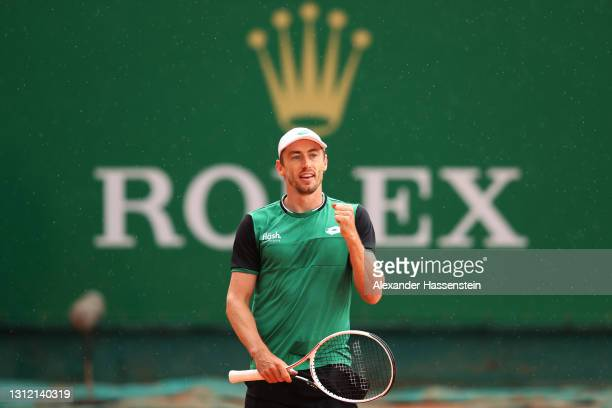 John Millman of Australia celebrates match point after winning his Singles Match against Ugo Humbert of France during the First Round of the Rolex...