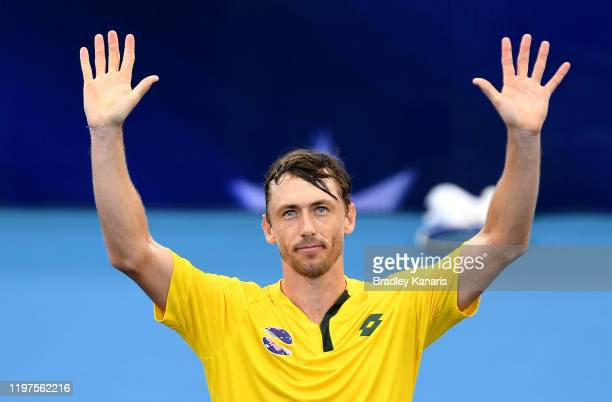 John Millman of Australia celebrates victory in his match against Felix AugerAliassime of Canada during day three of the 2020 ATP Cup Group Stage at...