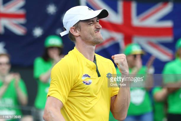 John Millman of Australia celebrates winning his match against Felix AugerAliassime of Canada during day three of the 2020 ATP Cup Group Stage at Pat...