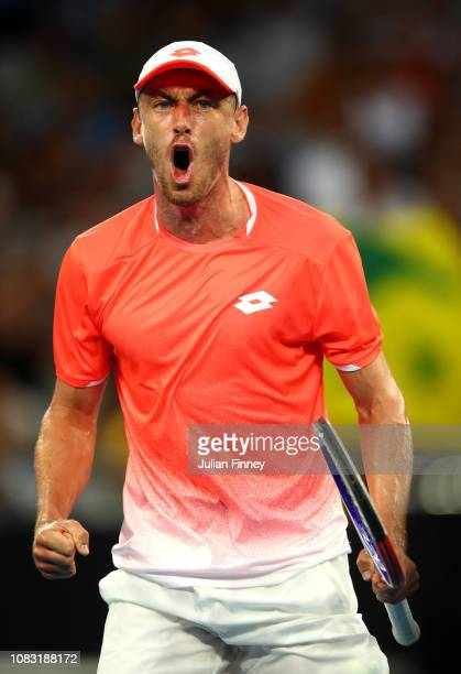 John Millman of Australia celebrates winning set point in his second round match against Roberto Bautista Agut of Spain during day three of the 2019...