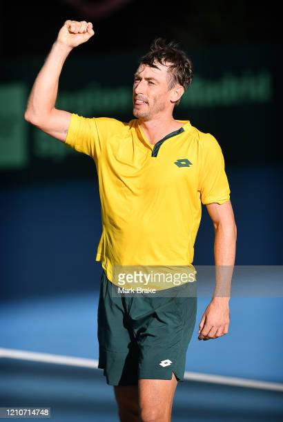 John Millman of Australia celebrates winning the match during the Davis Cup Qualifier Tie singles match between John Millman of Australia and Thiago...