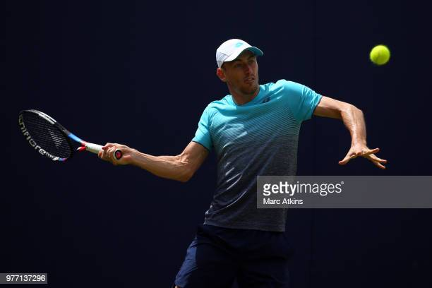 John Millman of Australia hits a forehand during his match against Marius Copil of Romania during qualifying Day 2 of the FeverTree Championships at...