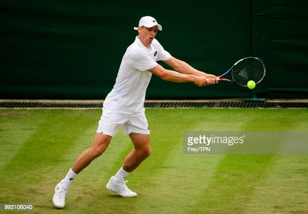 John Millman of Australia in action against Milos Raonic of Canada in the second round of the Gentlemen's Singles at the All England Lawn Tennis and...