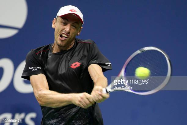 John Millman of Australia in action against Roger Federer of Switzerland during day 8 of the 2018 US Open at Arthur Ashe Stadium of USTA Billie Jean...