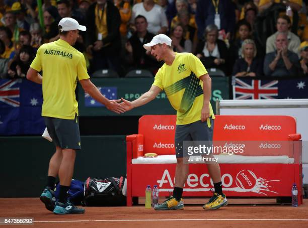 John Millman of Australia is supported by team captain Lleyton Hewitt against David Goffin of Belgium during day one of the Davis Cup World Group...