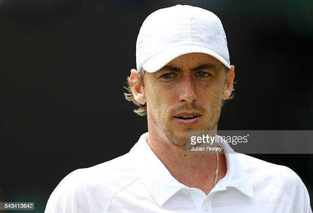 John Millman of Australia looks on during the Men's Singles first round match against Albert Montanes of Spain on day two of the Wimbledon Lawn...