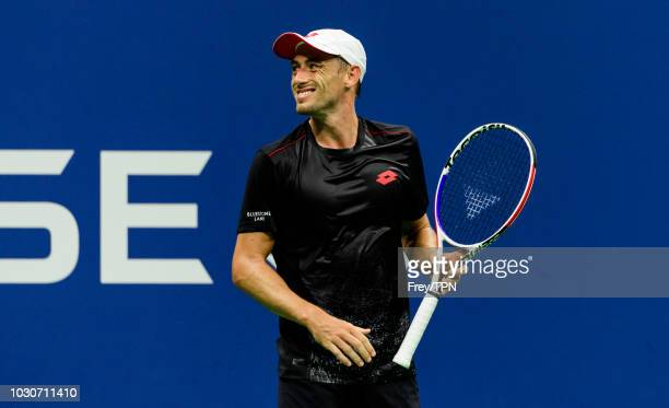 John Millman of Australia looks to his box against Roger Federer of Switzerland in the fourth round of the US Open at the USTA Billie Jean King...