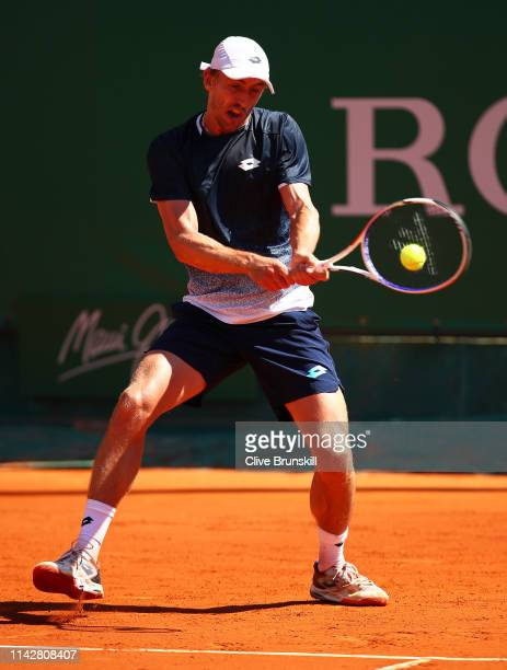John Millman of Australia plays a backhand against Roberto Bautista Agut of Spain in their first round match during day two of the Rolex MonteCarlo...