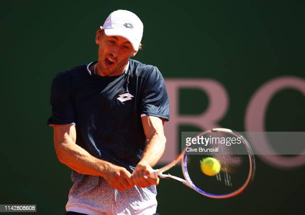 John Millman of Australia plays a backhand against Roberto Bautista Agut of Spain in their first round match during day two of the Rolex Monte-Carlo...